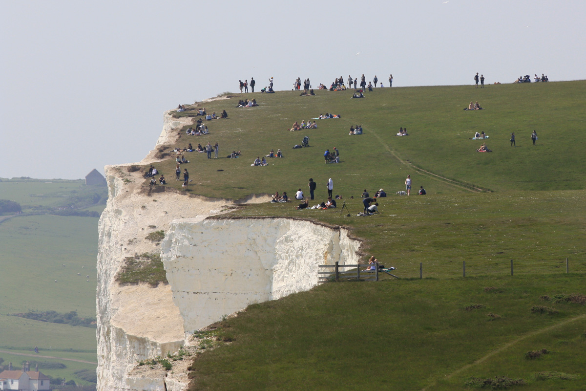 Lots of people very near the cliff edge at the Seven Sisters