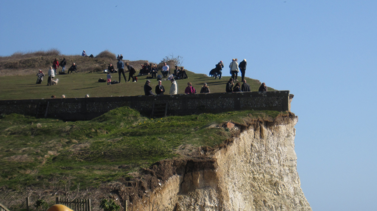 People near the cliff edge at Birling Gap